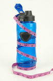 Blue Water Bottle With Measuring Tape Stock Image