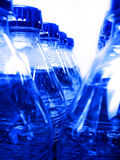 Blue Water Bottles. Rows of blue water bottles fresh and cold Stock Photos