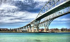 Blue Water Bridge, Sarnia, Canada. An image of the Blue Water Bridge that crosses the US-Canada border. This is a very important and busy bridge for cargo royalty free stock photo