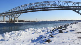 Blue Water Bridge Winter. The Blue Water Bridge connecting Port Huron, Michigan, USA with Sarnia, Ontario, Canada. The twin span bridge crosses the St. Clair stock footage