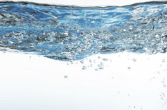 Blue Water with Bubbles and Waves Stock Photos