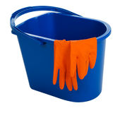 Blue water bucket and gloves. Isolated on white background royalty free stock images