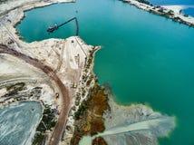 Blue water in career. Aerial view - blue water in pond, sandy career Royalty Free Stock Photo
