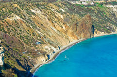 Blue water and cliff. A blue lagoon next to cliffs Royalty Free Stock Photography