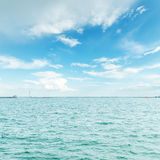 Blue water and cloudy sky Royalty Free Stock Photo