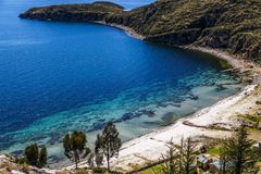 Blue water, coast of Titicaca lake and white sand beach at Incas Stock Image