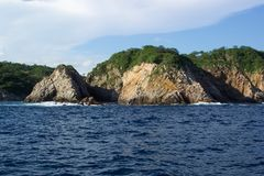 Blue Water Day. Photo of coastline of Huatulco Mexico Stock Photo