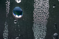 Water drops. Water drops on a steamy window Royalty Free Stock Image