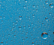 Blue water drop background Stock Photography
