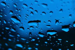 Blue water drop. Dew condensation on the windshield Stock Image