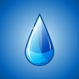 Blue water drop falling Royalty Free Stock Photography