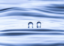 Blue water drop falling down Stock Photography