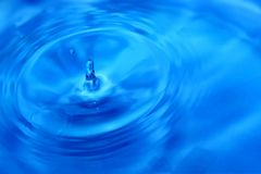 Blue water drop with waves on the surface. Second Stock Photo