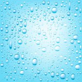 Blue water drops background. Stock Image