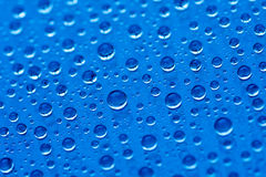 Blue water drops background Stock Image