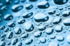 Blue water drops background. Studio macro shot Stock Photos