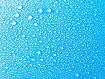 Blue water drops background texture Royalty Free Stock Images
