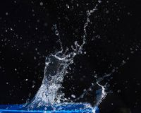 Blue water drops falling down. Stock Image