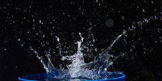 Blue water drops falling down. Royalty Free Stock Images