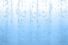 Blue water drops on glass Royalty Free Stock Photos