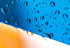 Blue water drops on glass Stock Photo