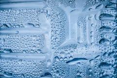 Blue water drops macro Stock Images