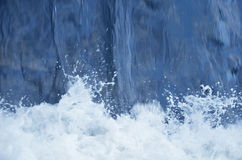 Blue water falling. Blue water flowing down to the white foam Royalty Free Stock Photo
