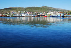 Blue water of fjord against the northernmost city Hammerfest. Stock Photos