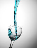 Blue water flows in a glas Royalty Free Stock Images