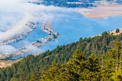 Blue water and fog. View of the Bolinas lagoon from the top of Mount Tamalpais in Marin County, beautiful day with some fog coming to the bay Stock Photography