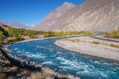 Blue water of Gilgit river flowing through Gupis. royalty free stock images