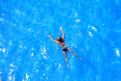 Blue water and girl. Royalty Free Stock Images