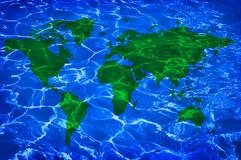 Blue water and green worlwide map Stock Photos