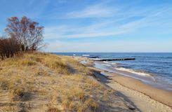 Blue Water Horizon. Lazy afternoon on a gorgeous beach with the turquoise waters of Lake Superior in the background  Whitefish Point Unit of Seney National Stock Image