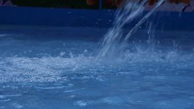 Blue water jet in swimming pool. children amusement park. slow motion stock video footage