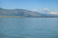 Blue water on the mountain lake Chaghytay in Tuva. Stock Images