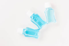 Blue Water Mouthwash On White Background. Royalty Free Stock Photo