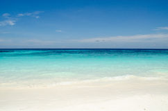 Blue water of the ocean and white sand, Similan Islands, Thailand. Stock Images