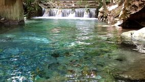 Blue water in pond. Waterfall and blue water in pond at thailand stock video footage
