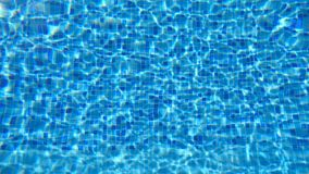 Blue water in pool. Beautiful background. Slow motion Close up stock video