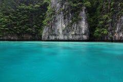 Blue water and precipice, phiphi, Phuket, Maya bay. Captured at a famous nature resort - Maya Bay, Phiphi island, Phuket, Thailand Stock Photo