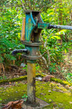 Blue water pressure pump column for water supply from well Stock Image