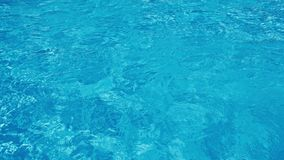 Blue water rippled background in swimming pool. 4K. stock footage