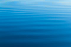Blue water ripples from the ocean Royalty Free Stock Photography