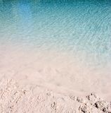 Blue water ripples sandy beach Royalty Free Stock Images