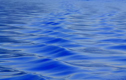 Blue water ripples surface Royalty Free Stock Images