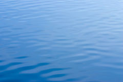 Blue water with ripples texture Royalty Free Stock Photography