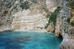 Blue water and rocks of beach at Zakynthos island, Greece Royalty Free Stock Photos