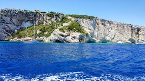 Blue water and rocks. Beautiful blue waters in Zakynthos blue caves zone Stock Photos