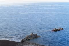 Blue water and the rocks on the Praia Formosa on Portuguese island of Madeira. Blue water and the rocks on the Praia Formosa - famous public beach on Madeira stock image